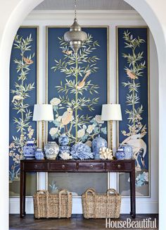 """I like making a statement in an entry,"" says Thornton, who commissioned custom panels by Allison Cosmos and massed blue-and-white porcelain from Charlotte & Ivy and Wisteria on an 1880s console."
