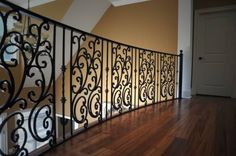 Wrought iron railing from one of our custom builds.