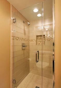 Master bath:  like the size of the shower tile with the stripe of glass mosaic. Love the inset square of the mosaic tile too