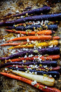 Delicious maple glazed carrots roasted with pure maple syrup and garlic. Topped with creamy goat cheese crumbles and crunchy pistachios -- this easy, veggie side dish will impress everyone at your holiday gatherings! Veggie Side Dishes, Healthy Side Dishes, Healthy Sides, Side Dishes Easy, Food Dishes, Healthy Meals, Vegetable Dishes, Healthy Eating, Vegetable Recipes
