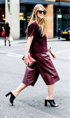Joseph's Social Media Editor Monica Ainley in leather marsala culottes paired with a boxy top, peep-toe mules, and colorblock Céline clutch. Photo by A Love Is Blind
