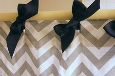 DIY  add bows to add some whimsy to your bathroom shower curtain