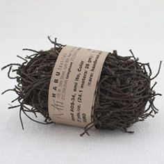 """From Habu Textiles - """"This is an ultimate recycled yarn, created from an used fishnet. This particular one comes from Indonesia, but we used to have them in Japan (in silk!), too. It is wild when you knit or crochet this with a large needle or with your own fingers! Very sculptural. The surface of this yarn is coated with persimmon tannin for an additional strength ..."""""""