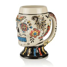 Made from stoneware and decorated in the style of an authentic Mexican sugar skull,  this mug celebrates The Day of the Dead.
