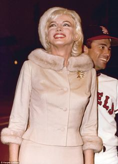 Monroe ran out on the infield of Dodger Stadium with Los Angeles Angels outfielder Albie Pearson for an Angels-New York Yankees game in August 1962. Marilyn was making an appearance in a pre-game ceremony on behalf of the Muscular Dystrophy fund. A record crowd of 51,584 fans watched the Yankees beat the Angels