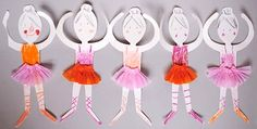 Paper doll ballerinas with crepe paper tutus.