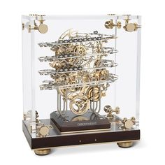The Physicist's Perpetual Motion Clock - Hammacher Schlemmer