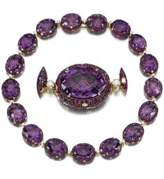 AMETHYST, RUBY AND DIAMOND PARURE. Designed as a series of facetted oval amethysts to a background pavé-set with circular-cut rubies and brilliant-cut diamonds, inner circumference approximately 385mm, together with a ring, size N, and pair of earrings en suite, clip and post fittings, part illustrated.