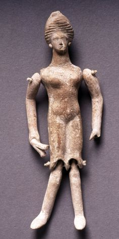 Terracotta dancing doll holding castanets. 350BC (circa), even then there was jointed dolls!
