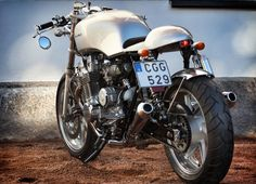 """Rewheeled #1, a Honda CB750 Cafe Racer from Swedish builder Adreas Norum. Not only did Andreas slim down the CB's rear end he's given the whole bike a modern Cafe Racer facelift that won it """"Best Streetbike"""" at the 2012 Oslo Motor Show."""