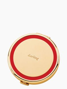 """The kate spade new york Holly Drive """"Darling"""" Compact Mirror is a must-have for your purse or pocket. An exquisite gold smooth compact opens to reveal a small mirror, ideal for fixing lipstick or hair. Makeup Bag Essentials, In Cosmetics, Compact Mirror, Gifts For Women, Bag Accessories, Red And White, Great Gifts, Kate Spade, Beauty"""