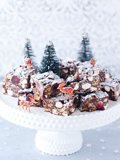It's not that I felt my usual Rocky Road Crunch Bars needed any improvement but I thought they would benefit from some seasonal adjustment. So, out go the Rich Tea biscuits and in come amaretti and – in the seasonal spirit – I've crammed in some Brazil nuts and glacé cherries (as red as Rudolph's nose), along with snowy mini marshmallows. The fresh snowfall of icing sugar on top might seem seasonal enough, but not for me. So I add some edible glitter in Disco Hologram White.