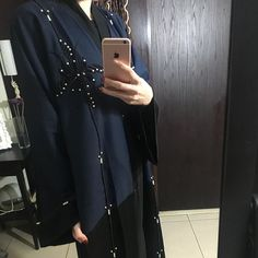 Last abaya in stock with hand work . Blue and black . Price 650 dirham