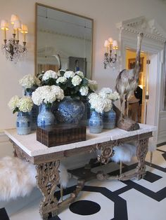 blue and white porcelain, ornate console, white hydrangeas and an ostrich statue- The Naked Decorator-