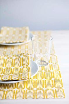 Scandinavian inspired design is an ongoing trend. Bring a little touch to your home with Scandi inspired table linens, such as this fun yellow print