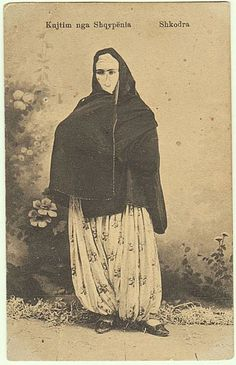 Imperial Austria, Albania: Vintage postcard after a cabinet photo, depicting an Islamic Albanian lady in burqa. The postcard is entitled: Kujtim nga