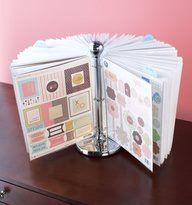 A paper towel holder with page protectors attached by binder rings...so many uses...recipes, show off art work by the kids, pictures.. DVD's ???