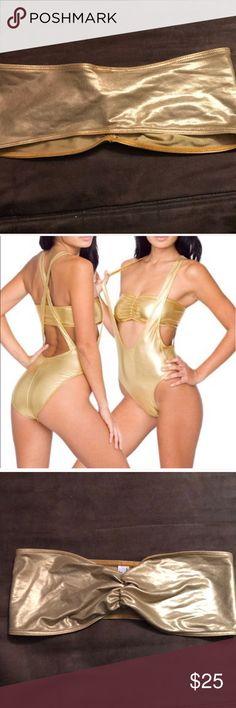 Liquid gold American apparel Bandeau bra bralette Size medium bralette  American apparel brand  No signs of wear gently used.   Tags: sexy, Golden, shimmer, shine, metallic, metal, bronze, Grecian, muse, Gogo, festival, mermaid, beach, hot, summer, top, swim, tube, workout, sport, party, dance, lingerie, intimates, nasty gal, boho, bohemian, gypsy, goddess, rock and roll, rockstar, Gaga, pop, star, glam, boudoir, burlesque, costume, genie, bodycon American Apparel Intimates & Sleepwear…