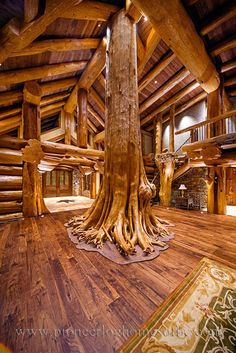 Amazing ceadar as family tree in great room. Round log post-and-beam home by Pioneer Log Homes of British Columbia