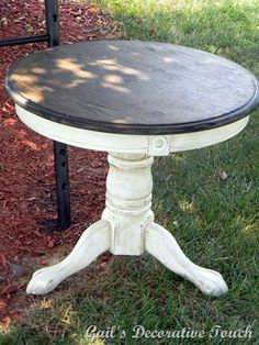 Cream with clear and dark wax with a stained top.