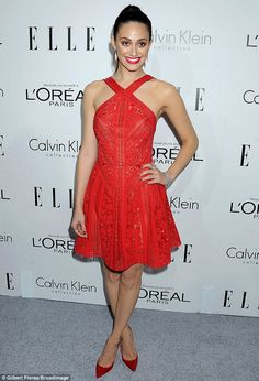 Red-hot! Emmy Rossum stuns in a halter necked red cocktail dress at Elle magazine's annual Women in Hollywood event