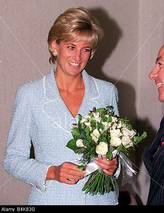 Princess Diana receives a Bouquet of roses Princess Of Wales Rose named after her from the British Lung Foundation April 1997 Stock Photo