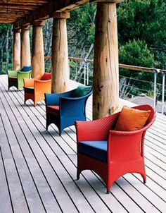 Colorful outdoor chairs and cushions - I do like a splash of bold color, here and there...