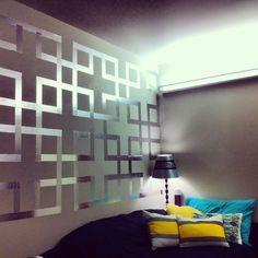 Foil tape wall art I did for my dorm room. Perfect way to cover up white walls! Very easy and cheap. DIY interior decorating.