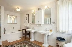 Country feel: The home has four full bathrooms and one half bath and each is a…
