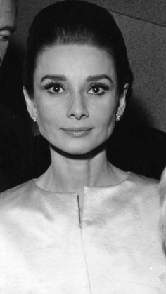 """Audrey Hepburn photographed at the Warner Theatre in London,England. Premiere of her new movie """"My Fair Lady"""",January 21,1965- Evening ensemble:Givenchy- Earrings:Cartier"""