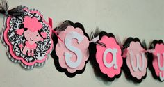Pink Poodle in Paris Name or It's A Girl Banner Pink, Black, and White Damask Stripe French Girl Puppy Party Decorations France Baby Shower. $22.50, via Etsy.