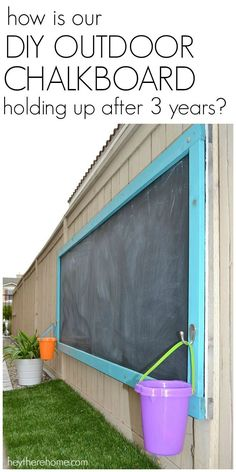 How Is Our DIY Outdoor Chalkboard Holding Up After 3 Years? 2019 I get asked all the time how our outdoor chalkboard has held up over the years so I thought I'd give you the update! The post How Is Our DIY Outdoor Chalkboard Holdi Kids Outdoor Play, Outdoor Play Spaces, Kids Play Area, Backyard For Kids, Backyard Play Areas, Outdoor Games, Backyard Games, Play Yard, Outdoor Pool