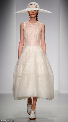 Zeynep Tosun showed off clever cutting skills with this stunning silver silk gown | London Fashion Week 2013