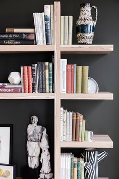 Bookshelves - Sophie Ashby, Modern Flat in Real Homes on HOUSE. See before & after this city flat was transformed by Sophie Ashby Furniture Outlet, Sofa Furniture, Discount Furniture, Furniture Plans, Furniture Design, Kitchen Furniture, Bookshelf Design, Bookshelves, Black Feature Wall
