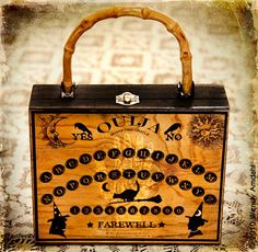 """Love this Ouija ""cigar box"" purse !!"" - I love this one... classy and spooky."
