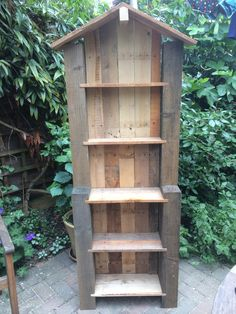 Auricula Theatre made from pallets and recycled fence posts.