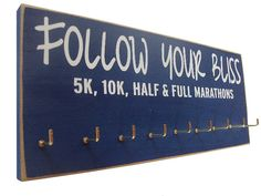 running medals display rack - 'Follow Your Bliss' ... this was made for me!! :)