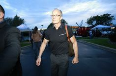 First glimpse: A stern-looking Dr Walter Palmer is pictured walking towards the front door...