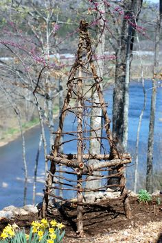 trellis--I need these for my cukes and green beans!  Of course, that also means I need cedar trees and vines. Shoot.