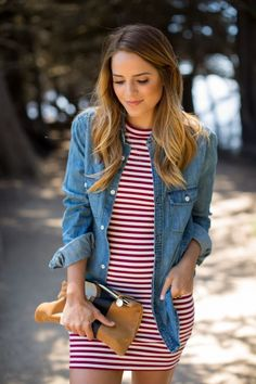 Julia Engel is wearing a denim shirt and striped dress from Aritzia, and a clutch from Clare Vivier