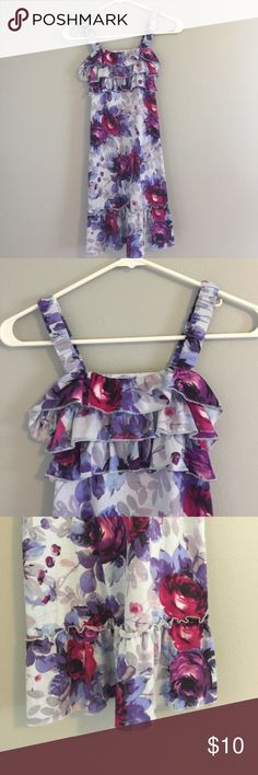 Girls summer dress Girls size Large (10/12) thick spaghetti strap summer dress. It has ruffles on the chest and bottom of the dress. It is a light blue with magenta and purple flowers. It also has a tie on the back. Xhilaration Dresses Casual
