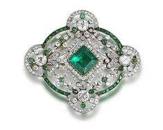 A Belle Epoque emerald and diamond brooch / pendant, circa 1910