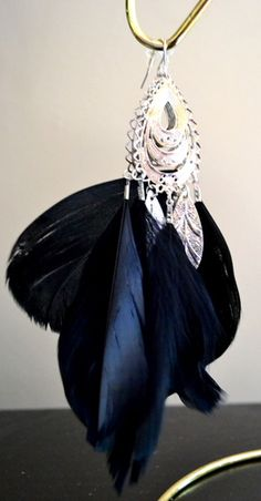 'Cruelty Free Feather Silver leaf  Chandelier ' is going up for auction at  3pm Mon, Jun 25 with a starting bid of $20.