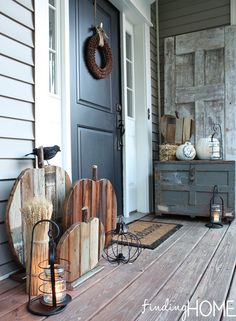 10 Fall Front Porch Decorating Ideas by A Blissful Nest - This front porch fall . 10 Fall Front Porch Decorating Ideas by A Blissful Nest - This front porch fall decor uses rustic wooden textures and neutral colors to make a bold fall statement. Wooden Pumpkins, Fall Pumpkins, Halloween Veranda, Outdoor Halloween, Cheap Halloween, Halloween Porch, Farmhouse Halloween, Rustic Halloween, Halloween Wreaths