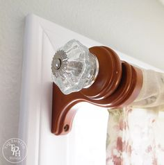 Want to get new curtain rods without actually having to buy new curtain rods? Do a curtain rod makeover using drawer pulls with this easy DIY tutorial!