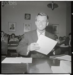 Robert F. Kennedy Holding Documents While Speaking Robert F. Kennedy is shown testifying at the House Labor Subcommittee on Juvenile Delinquency.  Date Photographed:28 June 1961