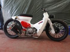 Custom honda cub streetcub built at camphill chop shop uk c90 c50 c70