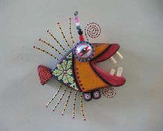 Twisted Piranha III, Original Found Object Wall Art, Wood Carving, by Fig Jam Studio on etsy. Materials: wood, wire, nails, beads, bottle cap, screws, paint.