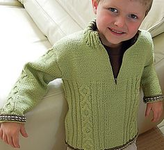 This smart jumper will keep your child cozy and warm and looks very trendy with a cable pattern down front and also on sleeves. Has contrasting trim.