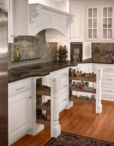 Custom counter pull outs - great storage idea for tall dry goods.